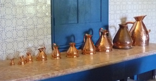 Brass jugs in kitchen