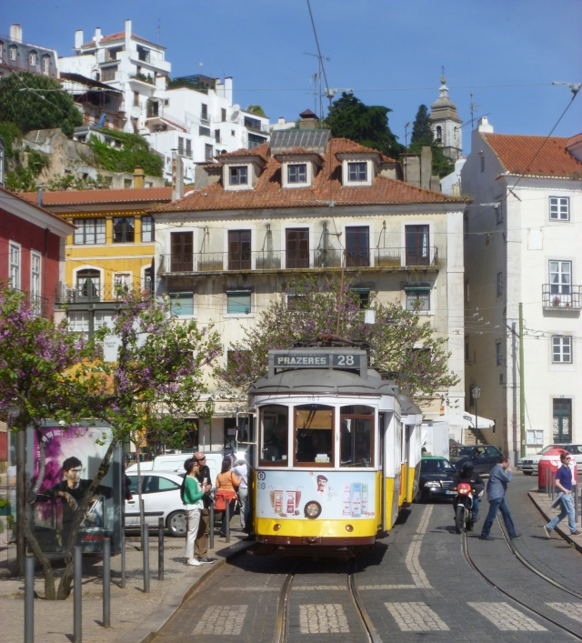 Tram 28 at the busy Portas do Sol