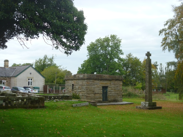 Mausoleum and cross and school