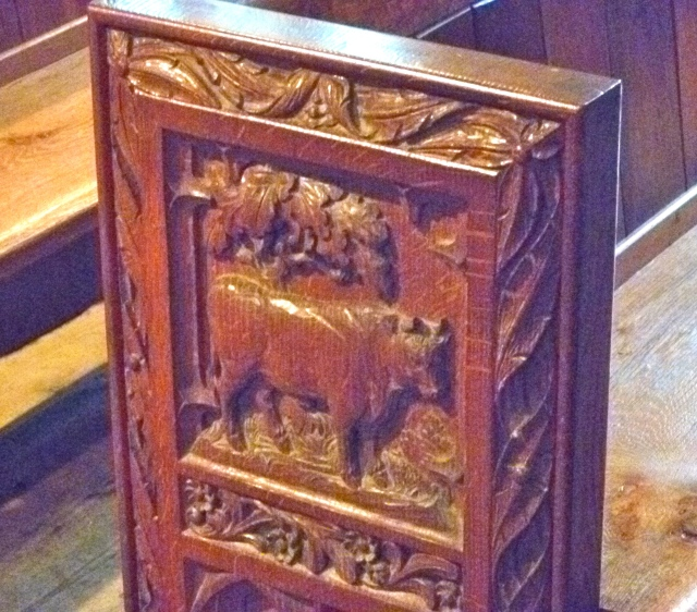 Carved pew end