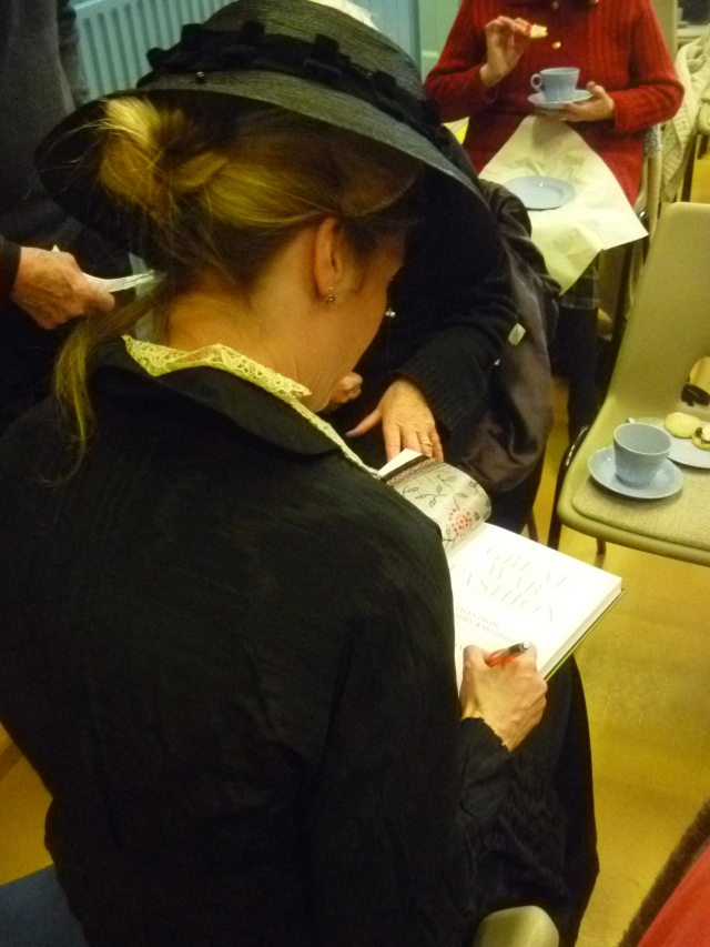 Lucy signs her book