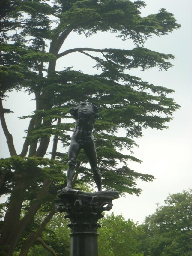 Walking man on column