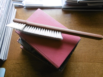 book brush and books