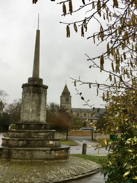 Helpston Cross and church